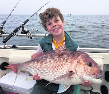 Hunter Blackford displays his lovely 7.80kg snapper before the weigh in.