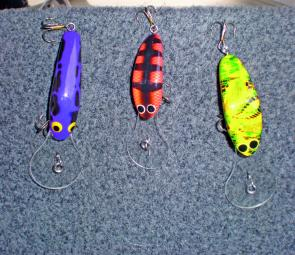 Three good lures for Glenbawn and St Clair: From left, the Horizon Banshee 65mm in purple/black (runs at 5m); Viking Talisman 50mm in Nepean perch (runs around 5m) and Viking Talisman 60mm in green pizza (runs down to 7m). All these are excellent trolling