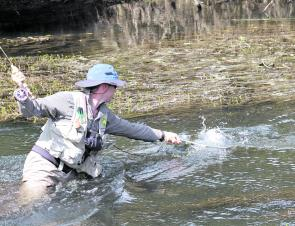 Danny Spelic nets a fish on the South Esk River.