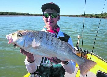 Rhett Thorne with a solid grunter pulled from the Fitzroy River near Gavial Creek. This fish fell to a River2Sea Fish Candy