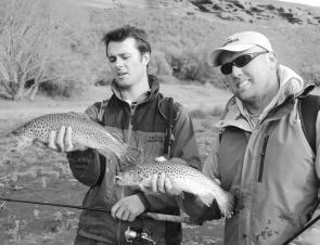 Scott Gray (right) and Neil Tedesco with two nice brown trout caught from shore for the cameras while filming an episode of Adventure Bound at Lake Purrumbete. The fish took 3 and 4 inch Gulp Minnows in Smelt colour rigged on 1g jigheads and cast t