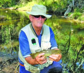 Geoff Johnston with a rainbow trout caught in the Gibbo River.