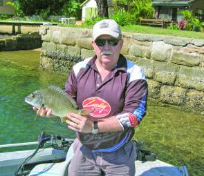 The author with a bream caught on a Lucky Craft NW Pencil in Yowie Bay.