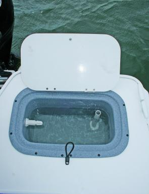 The live bait tank in the transom top is fully plumbed.