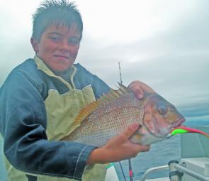 Kai Moriarty with a snapper caught on one of the shallow reefs off the southern Gold Coast.