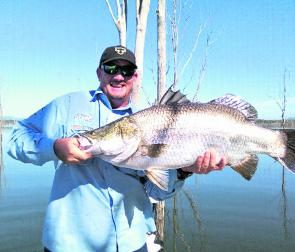 Dale Smith with a 1m barra. They will start feeding more aggressively in May to store up for winter.
