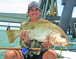 The author with a solid fish caught from a man-made structure that is used by golden snapper over the spawning season.
