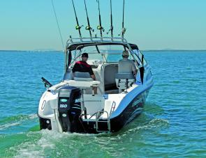 Twin live wells aft, a berley muncher, plus six rod holders make the Clearwater flagship a serious fishing rig.