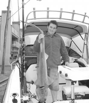 Daryl Lane with his first seven-gilled shark. It weighed 15.3kg.