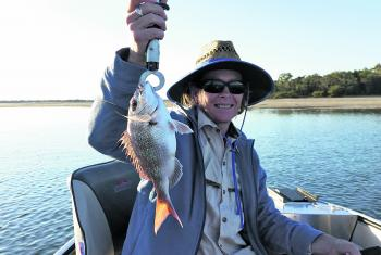 Sue Kerkow with a fun size squire taken in shallow water.