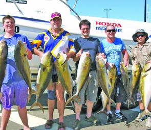 Happy Outlaw Charter clients with the end result from a couple of hectic sessions in 70m of water.