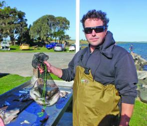 This visiting angler from Anglesea looks happy with a nice bag of whiting he caught near Mahers Landing on the run-in tide.