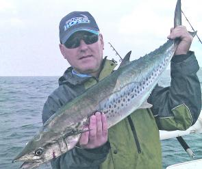 Chris Blanch from Port Macquarie Tackleworld with a spotted mackerel caught at Barries Bay.