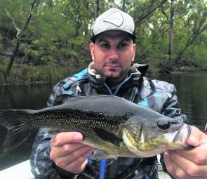 John with a nice bass that took a liking to a Megabass Siglett on a rainy day.