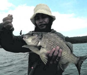Elvie with a big bream caught during a hectic session on vibes in the Bottom Lake.