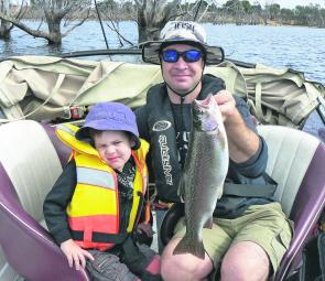 The author and his son Rusty with a typical Toolondo rainbow trout.