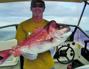 Roy Lane with a soft plastic caught snapper from the deep reefs wide of South Passage Bar.