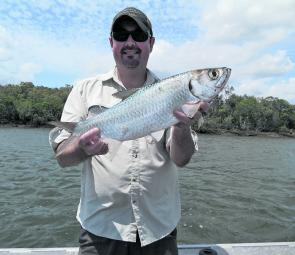 The author's first tarpon caught on a floating half pilly from the Logan River.