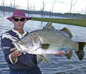Johnny Mitchell with one of the barra that features in his DVD Lake Monduran, and Aussie adventure.