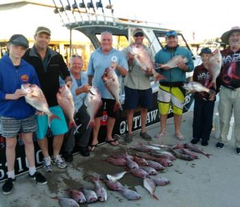 A happy group of angler with more quality red fish.