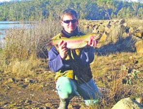 Mic Rybka with a magnificent rainbow trout caught off the bank at Brushy Lagoon in Tasmania using Powerbait for bait. Powerbait is readily available at most tackle stores and works exceptionally well in waterways stocked with advanced trout such as family