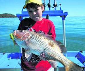 The author's son, Jordy, with a decent fingermark he caught while jigging plastics.