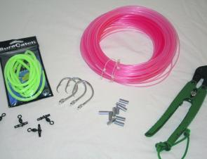 All the requirements to make up a deep drop rig. A roll of 300lb mono, some crimps and swivels to suit, 16/0 Mustad circle hooks and a roll of glow tubing.