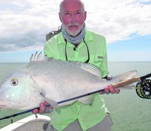 John with a big painted sweetlip (blue bastard) sight cast on fly on the flats and rocky areas around Weipa.