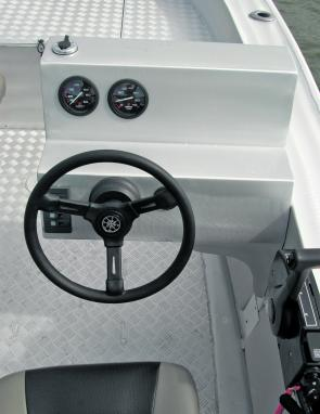 The McLay's side console offered a lot of area on which to set up both nav aids and large screen fish finders.