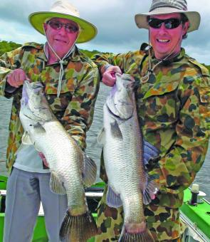 John and Gavin Blaik show off some typical winter barra.