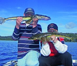 Wayne Mauger and son Jack are more than happy with their lure-caught flathead.