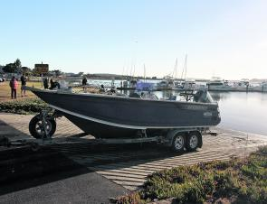 Michael Haley's Bar Crusher 670XS ready for another busy day chartering on Georges Bay. The Bar Catch makes launching and retrieving very simple and straightforward.