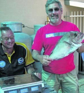 John O'Neil gets the weighmaster's approval for his winning snapper.