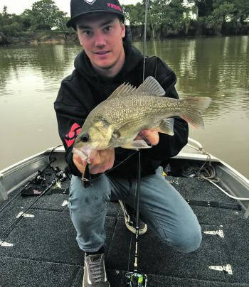 Aidan Kane with a chunky estuary perch from a local creek.