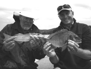 Bream and whiting are great species to target during February. Here Adam and Bucky display a pair of quality fish caught on plastics.