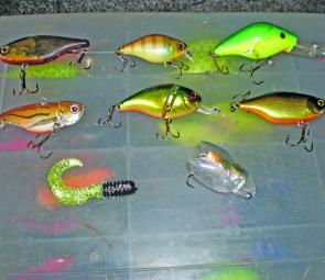 "Lures for June: From left, top row, Jackall Mask, Jackall Cherry, Mann's 15+; middle, Evergreen 1/2oz blade, Jackall Aragon, Jackall TN60 Silent; bottom, 2"" soft grub and the Smith Bisen, a good surface lure to fish from bank on windy days."