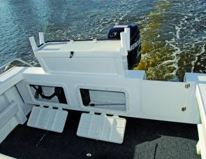 Off-floor shelving for batteries and other items makes sense in a craft that is certainly going to see its share of offshore work. The transom door is also a great asset.