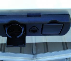 The glove box has twin fold-out drink holders.