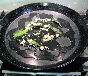 Sauté garlic and bay leaves in olive oil.