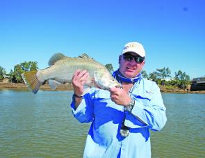 The author with a barra taken from the Burnett River.