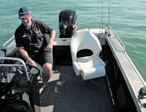 Seated at the helm station, Guyla is using the Lowrance HDS7 to find some more fish to play with.
