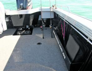 The Renegade's rear cockpit area. Features are easily noted, as well as the area where the 2 rods are standing, which made a very handy spot to fish from in choppy conditions.