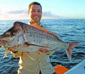 Jeremy with a 7kg soft plastic caught snapper taken on 6kg mono at Smiths Reef just after 6am in mid-October. The jighead is a 1/4oz and the lure is an albino shad with a 40lb fluorocarbon leader. He was casting ahead of the drift as his boat drifted east