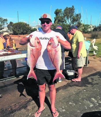 Jake Hilbert and a pair of beautiful Hastings snapper.