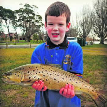 Jakey Young with a lake Wendouree Brown Trout caught casting Ecogear Soft Plastics with Dad Ben (Who said school pickup was no fun!)