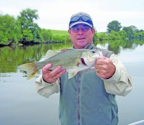 Derek Crossdale with a river bass that fell to a fizzer.