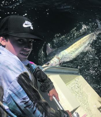 Deacon Stone releasing a great marlin.
