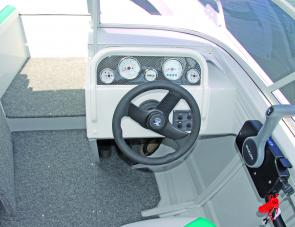 A functional but compact dash area is a positive design feature of the Blue Fin 5.25 bow rider Sports.