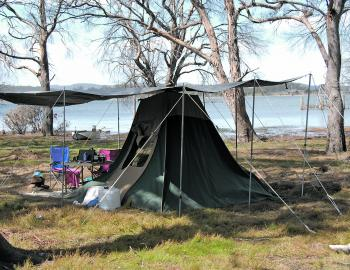 Camping at Arthurs Lake, Tasmania, the author supported the tent fly with a lot of poles and ropes, as strong winds were forecast.
