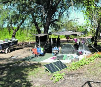 A campsite with the works – a decent shade fly, ground cover and solar panels to charge a spare battery. High output panels are bulky and it pays to find out how many are required for a given task.